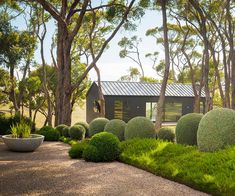 Located on Victoria's Mornington Peninsula, this coastal country inspired garden is full of zen, packed with Australian natives and manicured hedges.