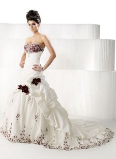 A great alternative to an intricate lace gown would be this one. The red accents will be replaced with blue.