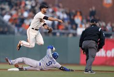 San Francisco Giants' Brandon Hicks (14) makes the double play against Los Angeles Dodgers Dee Gordon (9) in the first inning at AT&T Park in San Francisco, Calif., on Wednesday, April 16, 2014. (Josie Lepe/Bay Area News Group)