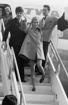 Twiggy and friends disembark from a TWA flight.