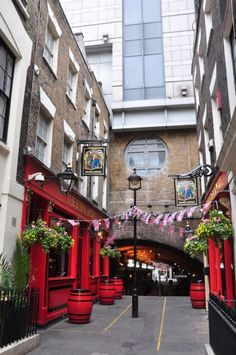 LONDON: The Ship and Shovel in Charing Cross, London. The only London pub that is on both sides of the street, joined by an underground cellar