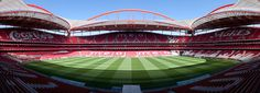 "Panorama of Estádio do Sport Lisboa e Benfica, Lisbon, Portugal.  It is the home stadium of association football club S.L. Benfica. The stadium, which has a capacity of 65,400, opened in October 2003, and has hosted several major games, including final of the 2004 European Championship. The name translates to ""Stadium of Light"", a common theme in Portuguese Catholicism. It replaced an older, larger stadium, also called Estádio da Luz. Photo: Massimo Catarinella"