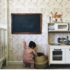@wwjasd can you come redecorate my room from the wall paper to the vintage chalk board to the striped fabrics in that mini kitchen. It's perfection. Good job mama! // flora ruffle jumpsuit #carlymegan