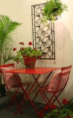 Geraniums,  Fairy Lights around a hanging basket and a red Fermob Bistro set  make a very pretty Christmas balcony  Small Balcony Furniture