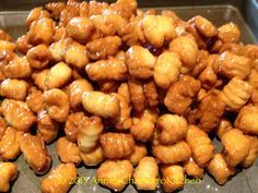 GUYURIA - (Pronounced gu-ju-ree-ah) This is another traditional Chamorro cookie (Rosketti is another).  Some of my friends call them jawbreakers because of their rock-hard texture. This cookie is not baked, however, it is DEEP FRIED and glazed in a thick sugar syrup that hardens when dry.