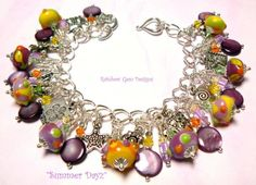 'Summer Dayz' Artisan Multi-Colour Lampwork Bead Charm Bracelet with Swarovski Crystals, MOP Purple Shells and Tibetan Silver Charms By Rainbow Gem Designs ………… Proud SRAJD member 1373  And now a proud member of Etsy DUST (Down Under Street Team)    This wonderful 'Spring Blossoms' Bead set was made by a NEW favourite artist of mine here on Etsy – Janell of 'Janelson Arts Handmade Wearable Glass Art' (etsy shop), JanelsonArts (etsy ID). They are a gorgeous mixture of Yellow, Green, Orange…