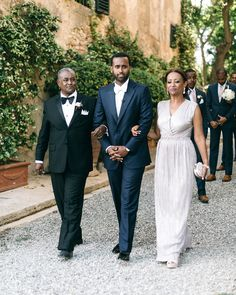 "Mickey was all smiles as he and his parents entered the ceremony to the sounds of ""At Last"" by Etta James. #weddingceremony #weddingtuxideas #motherofthegroomdress #weddingprocessional 