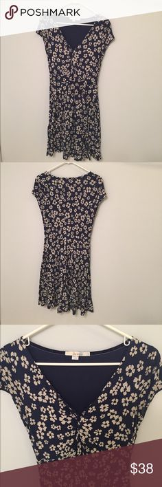 Boden Blue and White Floral Dress Fitted flattering V neck with floaty, skirt lined boden blue and white dress. On the small size of 8 so would be perfect for 6 as well. Stretchy. 39 inches from shoulder to bottom. Boden Dresses Midi