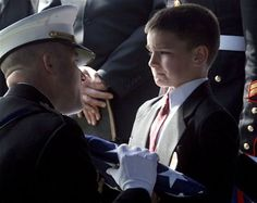 Even though this is from a film, the little boy's being given the flag. That means both his parents are gone...