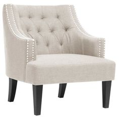 Birch wood arm chair with nailhead-trimmed linen upholstery and foam cushioning.Product: ChairConstruction Material: L...