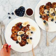 Mimi Ikonn | Banana pancakes topped with bananas, blueberries, coconut flakes, and maple syrup | Delicious | Healthy
