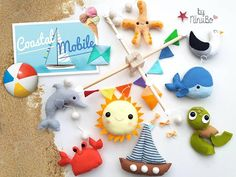 Hello and welcome to NiNuBo Made to order mobile, please check creation time on my main page Coastal Baby Mobile  I hand make all my mobiles from scratch, using quality felts and materials. Each character is drawn, cut and then stitched by hand.  INCLUDED  1 Whale 1 Turtle 1 Sun 1 Boat 1