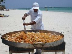 Do YOU Love Paella? I've been eating this fabulous food that originated in Spain since my first visit to Spain..The Costa del Sol (Malaga,Toremolinos,Marbella) in June 1973. Since then..many Caribbean Resorts created their own style of seafood,saffron,rice. Here is a chef at an all inclusive resort in Punta Cana,Dominican Republic. Can YOU handle this? 1great-trip.com