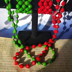 Red or green paper bead necklace and cuff bracelet sets ready to ship. Benifits www.HopeHeartsMinistries.org  $15