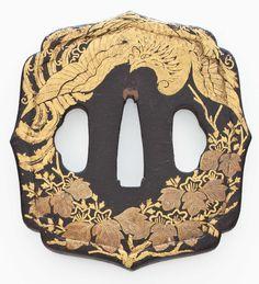 A mokko shaped iron tsuba EDO PERIOD (18TH - 19TH CENTURY)
