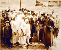 Charles E. Grace, a wealthy and famous African American religious leader and evangelist, is shown performing a baptism at the Oakland, California waterfront in front of World War I barracks with his racially integrated congregation | Picture This
