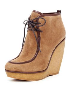 Wedge suede ankle boot. Nice transition into spring. KORS, Michael Kors Evans Wedge Boot.