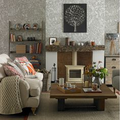 11 things Gogglebox has taught us about decorating >>>> Fireplace!! Look at that logburner. Gorgeous styling on the chimney breast. I especially like the raw mantlepiece.