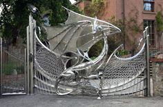 Dragon Gate of Harlech House, Dublin. Harlech House is famous for its dragon gates, was originally built in 1798 but in 1993 a huge redesign commenced which sought to celebrate the Jubilee, and also provide a home to a large family.