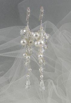 Pearl Crystal Bridal Wedding earrings Long Dangle Swarovski Crystal Bridal Earrings, Vintage drop earrings,  Postively Platinum Earrings. $35.00, via Etsy.