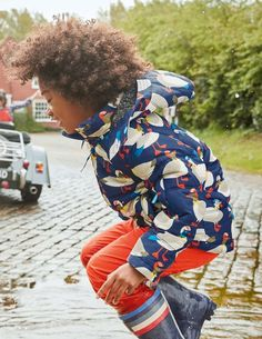 Stay as snug as a hug in this fleece-lined jacket. It's shower resistant and has reflective detailing to keep you safe during adventures on darker evenings. Between you and us, we've also added a secret zipped pocket on the arm – perfect for storing all your little treasures.