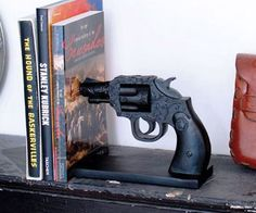 Revolver Bookend  Keep all the reading material in your home organized just like they did in the olden days with the revolver bookend. This incredibly life-like revolver is styled after the antique revolvers made famous by the spaghetti westerns of the silver screen.  $40.00  Check It Out  Awesome Sht You Can Buy