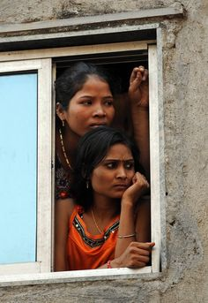 sex workers watch a skit on HIV-AIDS awareness on world AIDS day in mumbai's red light district of kamathipura.