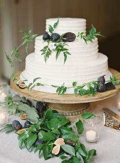 simple white layered cake adorned with greenery and figs | Photography: Jen Huang