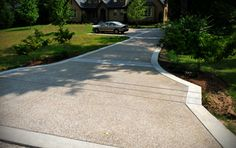 exposed aggregate with plain concrete border, patterned saw cuts instead of boring sections.