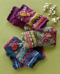 Posie Handwarmers – fleece-lined floral wool handwarmers. Posie Handwarmers – fleece-lined floral wool handwarmers.Posie Handwarmers: Our fleece-lined floral wool handwarmers add a happy note to your winter ensemble with brightly blooming flowers in a Crochet Gloves Pattern, Crochet Mittens, Knit Crochet, Crochet Hats, Wrist Warmers, Hand Warmers, Knitting Projects, Crochet Projects, Hand Knitting