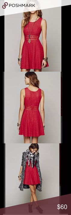 """Free People Fitted with Daisies Dress Free People Fitted with Daisies Dress   Retails for $128   Texturized fit-n-flare tank mini dress with daisy chain cutout detailing around waist. Zips up the back.    Back zip closure. Partially lined. Cotton/nylon; hand wash. By Free People; imported. Color: Tibetan Red Bust: 28"""" Waist: 24"""" Length: 28"""" Free People Dresses"""
