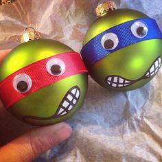 Ninja Turtle Ornaments: - green ornaments - colored ribbon of choice  - googly eyes - white paint pen - black paint pen - hot glue gun