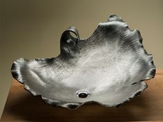 Oak Hill Iron has just created a Beautiful New line of Organic Vessel Sinks! Each sink is hand forged stainless steel and will create a Fabulous new look for your home!  To see detail pictures...please look at our web site:  www.oakhilliron.com