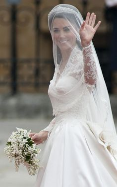 Kate Middleton's veil on her wedding day: The veil is made of layers of soft, ivory silk tulle with a trim of hand-embroidered flowers, which was embroidered by the Royal School of Needlework. It was held in place by a Cartier 'halo' tiara, lent to Miss Middleton by The Queen.