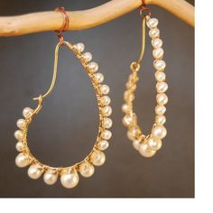 Hammered drops wrapped with ivory pearls Cosmopolitan 48 by CalicoJunoJewelry on Etsy https://www.etsy.com/listing/97754949/hammered-drops-wrapped-with-ivory-pearls