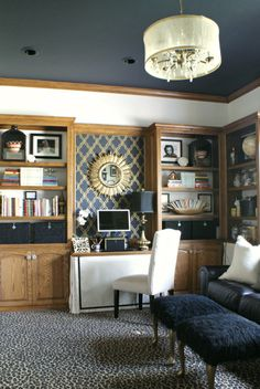 Good use of paint with oak trim. {Martha Stewart Wrought Iron} Painted ceiling with oak trim Martha Stewart, Honey Oak Trim, Oak Bookshelves, Book Shelves, Oak Wood Trim, Navy Walls, White Walls, Cream Walls, Savvy Southern Style