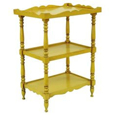 Three-tier birch wood accent table in yellow with turned legs and a scalloped apron.  Product: Accent tableConstruct...