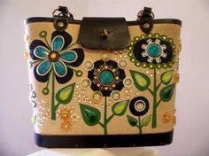 I love vintage Enid Collins bags