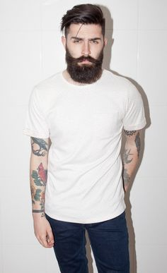 There's something about a man in a plain white T-shirt