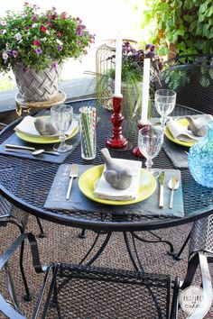 Love Love Love this - def going to copy... Outdoor table setting with slate placemats. So fun and colorful!