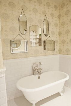 Sweet vintage bathroom with Thibaut Wallpaper, beveled subway tiles, clawfoot tub . Bad Inspiration, Bathroom Inspiration, Bathroom Ideas, Mirror Bathroom, Mirror Mirror, White Bathroom, Bathroom Accents, Framed Mirrors, Hanging Mirrors
