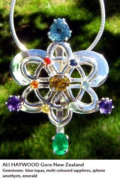 Soul necklace made for Ali Haywood (Gore, NZ) set with blue topaz, multi coloured sapphires, sphene amethysts and emerald.