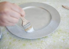 DIY metallic glitter chargers *Also paint and glitter old plastic bottles to use as flower pots*  Family Picnic