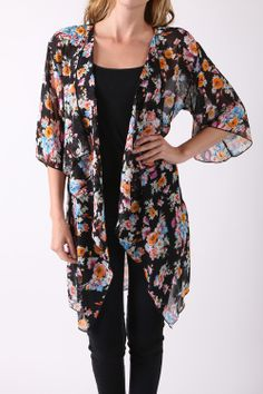 Fall in love with this adorable floral kimono cardigan.  Lightweight and soft, this kimono cardigan will be your go-to for your favorite casual and dressy occasions.  Color: black Size: S-L Material: 100% Polyester Made in USA