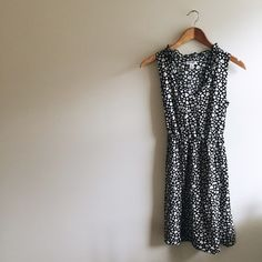 Vintage Style Dotted Dress Perfect for fall!! •Black dress with white hearts (look like dots) • about Knee length   •silky material  •Has a belt that can be tied to a bow  •Excellent condition  • perfect for an indie, hipster, vintage style   Closet policies:  No trades  No PayPal  Bundles =5% Discounts Old Navy Dresses Midi