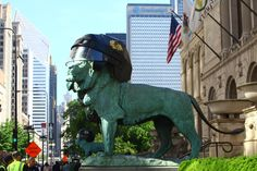The #Blackhawks helmets are on and these lions are ready for Game 1! #StanleyCup #ArtInstitute