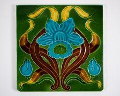 Antique 1900s English Art Nouveau blue daffodil pottery tile. by SimonCurtisAntiques on Etsy https://www.etsy.com/listing/482692506/antique-1900s-english-art-nouveau-blue