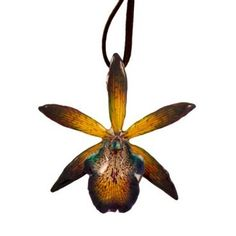 Cattleya, pronounced cat-lay'-a is also know as The Queen of Orchids.    This stunning orchid was picked at it's perfection and has been preserved in resin for you to enjoy for a lifetime.    This preservation process can take up to a week per flower with several coats of resin applied in stages to make it as durable as possible.    Orchid size is about 3 inches high and 3 inches wide.  (Orchid size will vary as each flower is one of a kind) $45