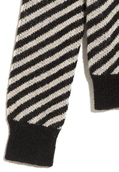 A soft mohair blend sweater with unique diagonal stripes. Black and Natural. Shop more by YERSE