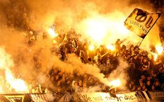 Red Star fans light flares during Serbia's National Cup semifinal match against Partizan in Belgrade